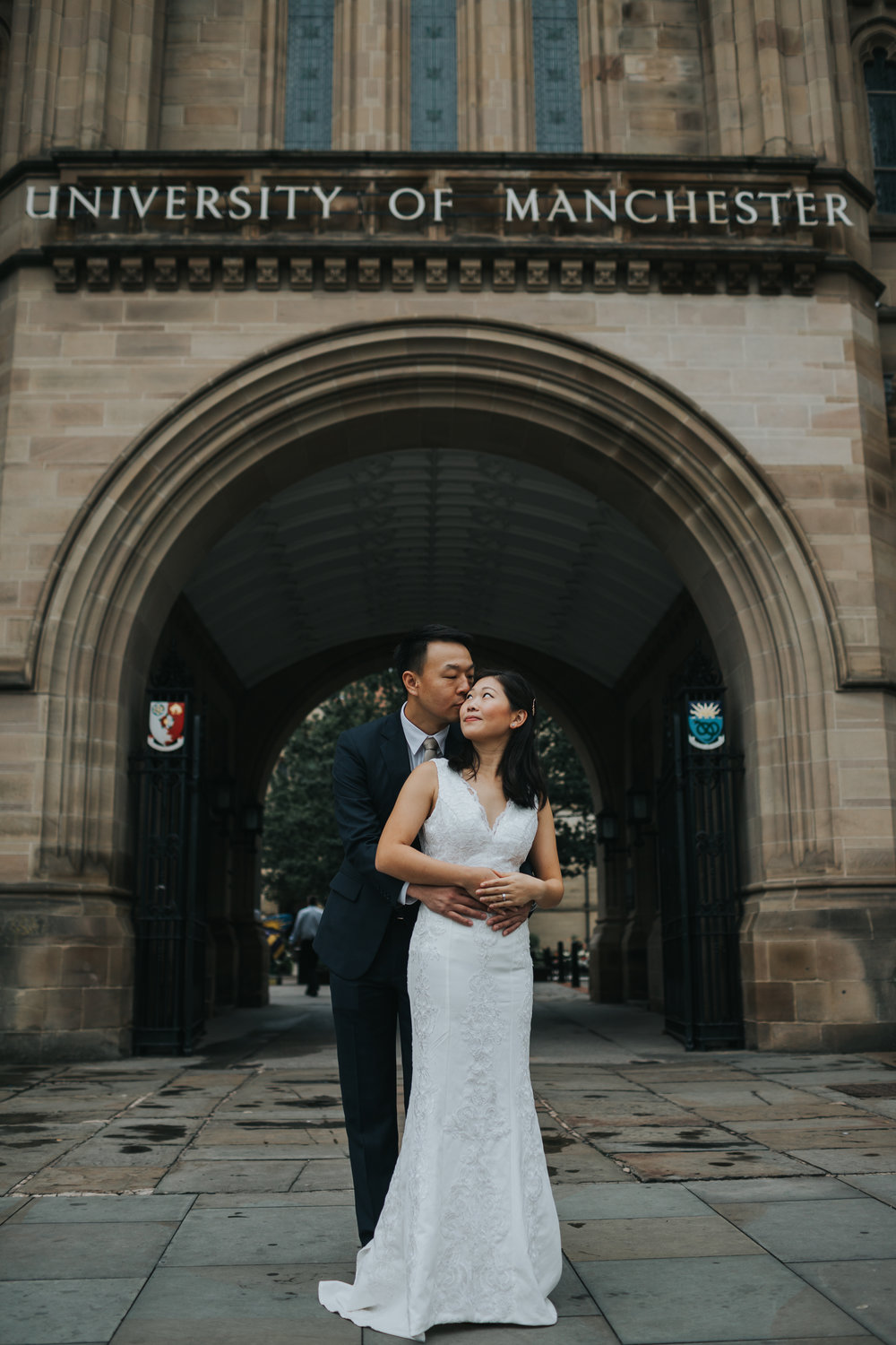 Couple embrace outside Manchester university, where they first met.