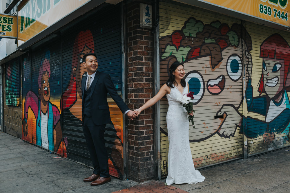 Couple Holding hands outside Fresh Bites take away in Manchester's infamous Northern Quarter.