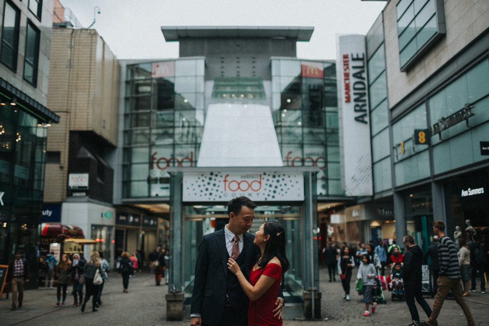 Couple embrace outside Market Street Food Court.