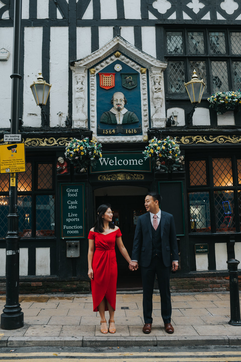 Couple stand outside Shakespeare pub Mancheseter.