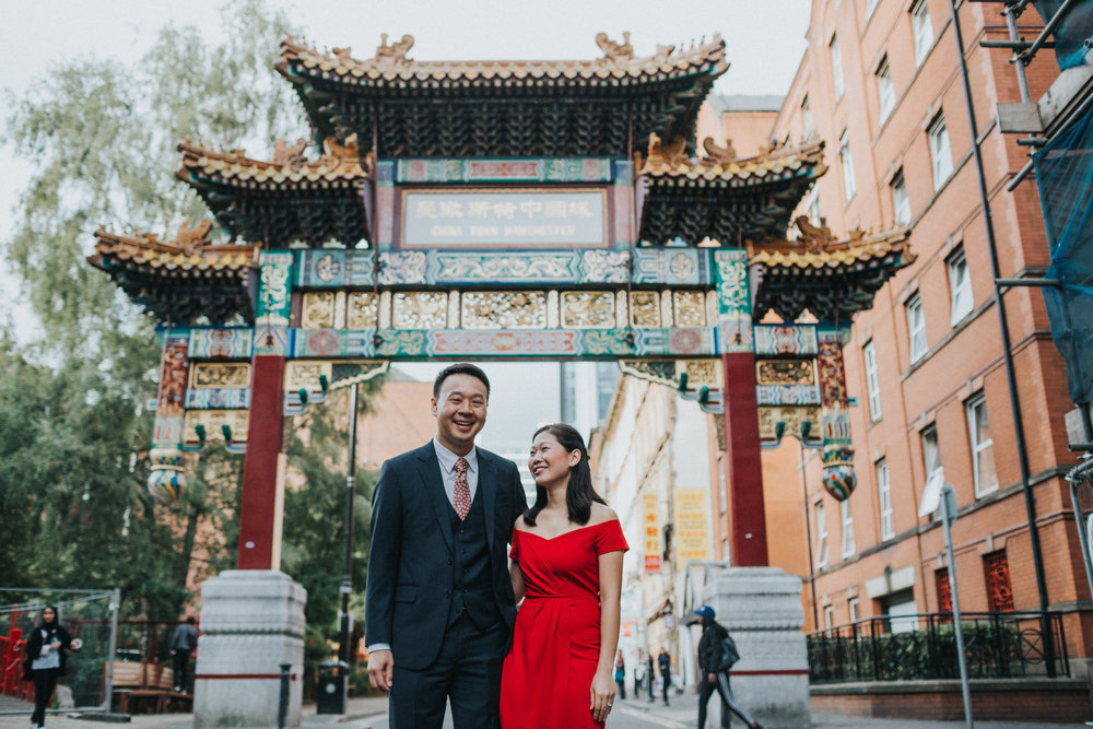 Groom laughs under China Town Arch.