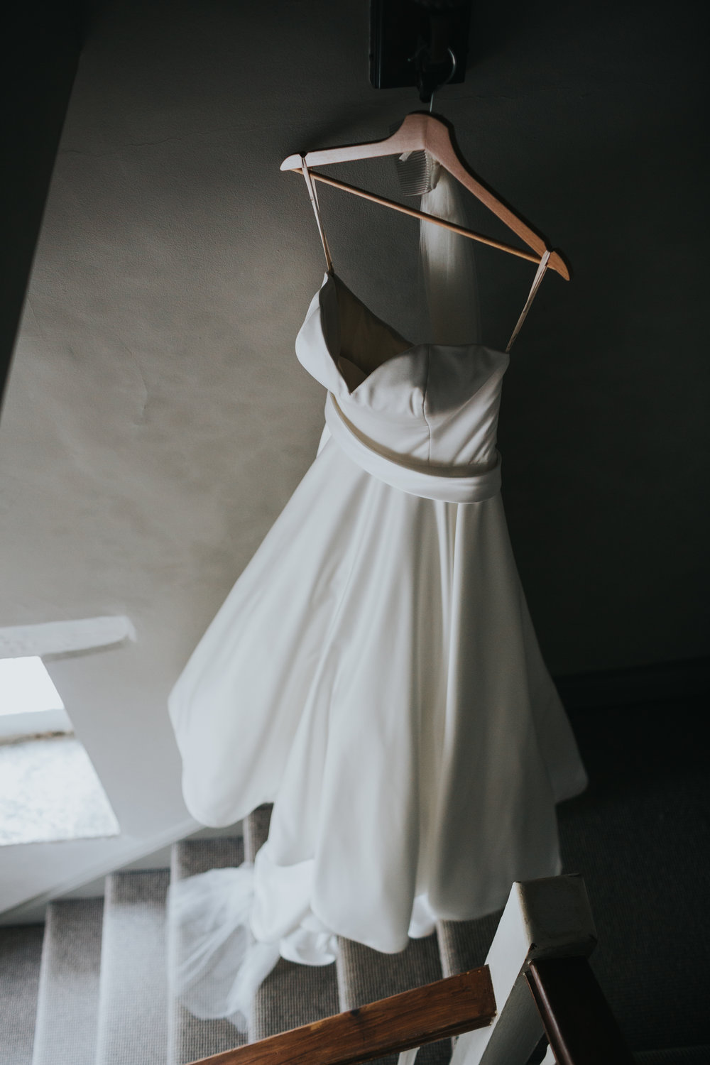 Wedding Dress hanging in the hall way.