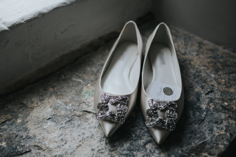 Brides shoes on windowsill with 6 pence inside.