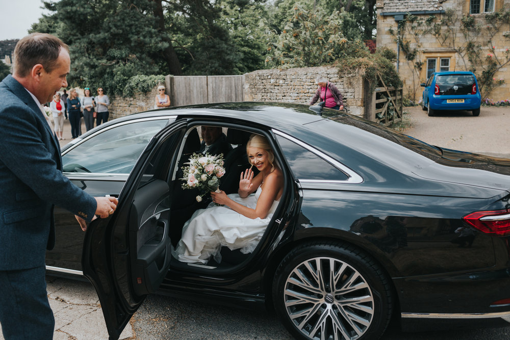 Bride arrives in wedding car.
