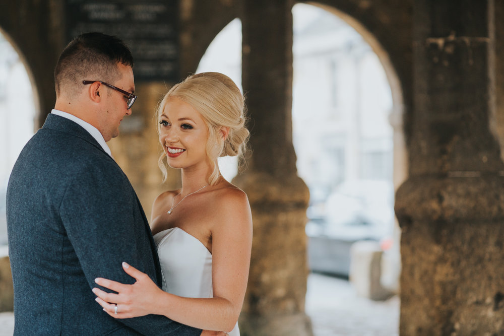 Bride and Groom together in old Chipping Market Hall.