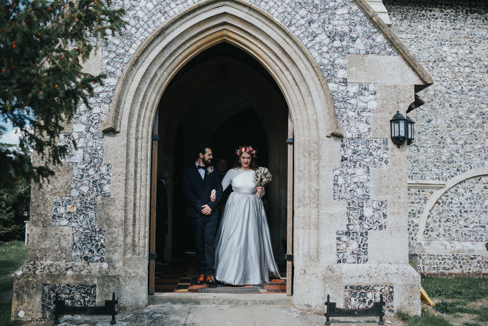 Bride and Groom leaving St Mary's Church, Aldworth together as a married couple.