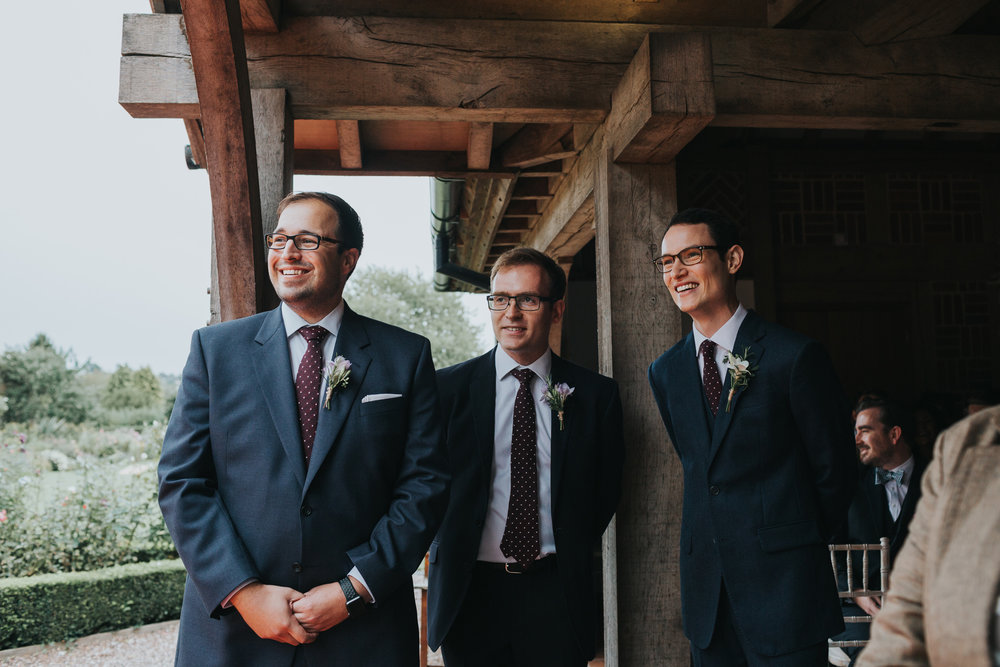 Groom and his groomsmen stand waiting for his bride to arrive.