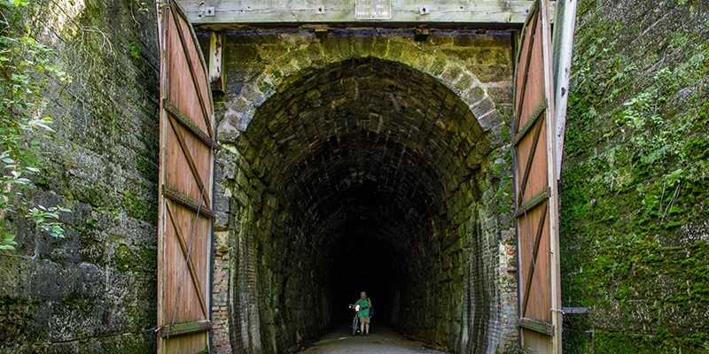 One of three large tunnels that the Sparta-Elroy trail passes through. Photo by TravelWisconsin.com
