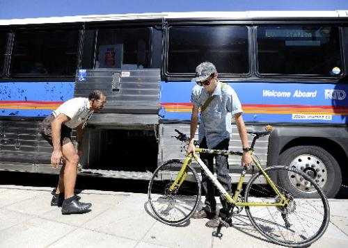 Denver's RTD (transit buses) take people between Denver and Boulder and accept bikes in luggage.