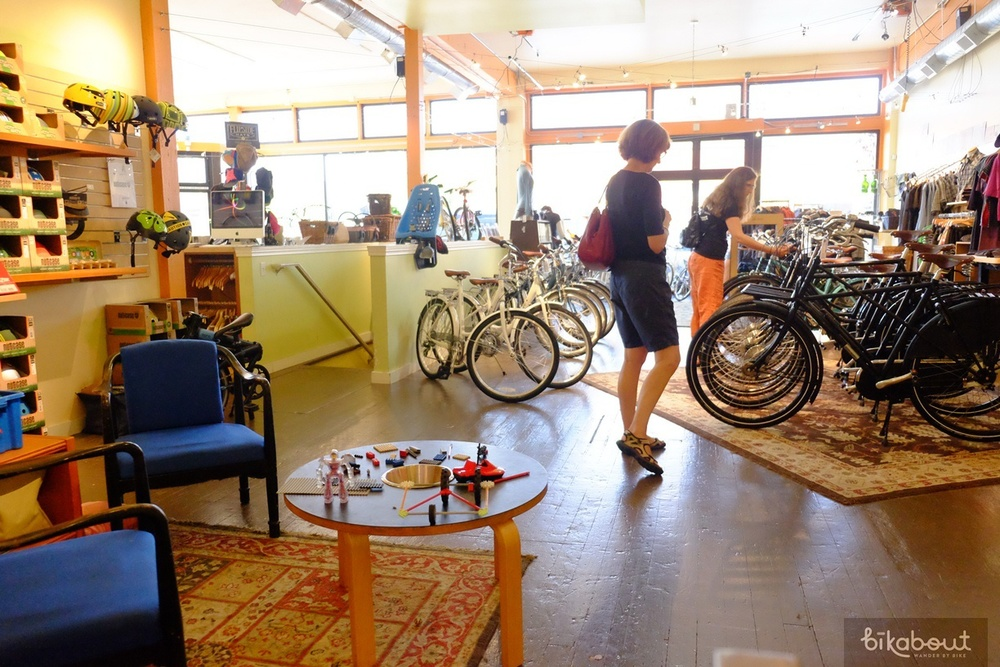 Clever Cycles in Portland has the bike shop business down to science: provide high quality, transportation bikes as rentals, sell city and family bikes, dazzle people with a wall of accessories that will make them open their wallets and provide a bathroom, sitting area and toys for families.