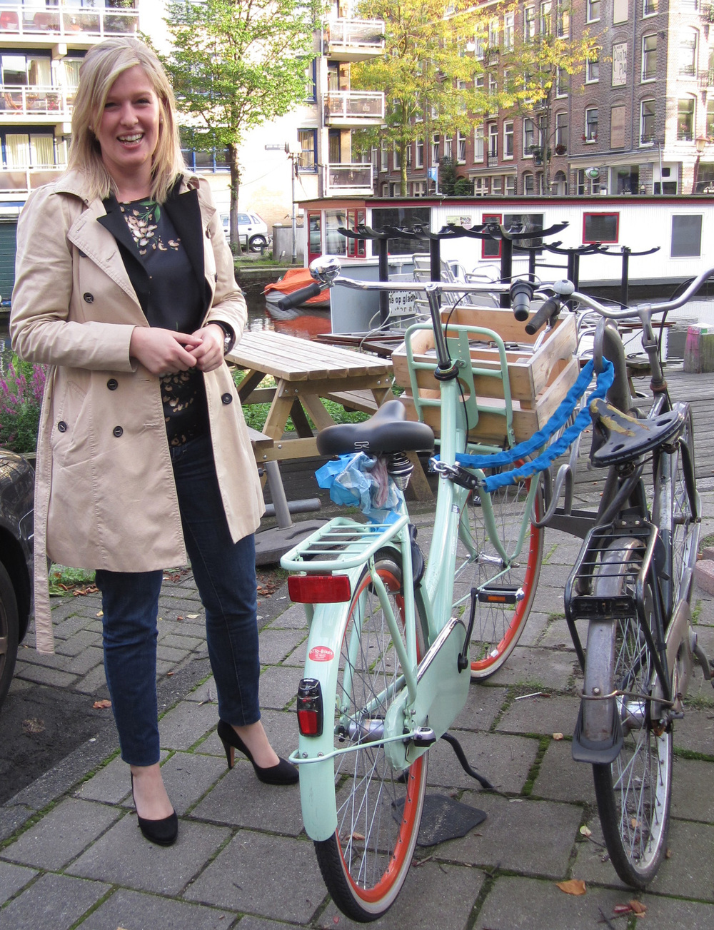 "Amsterdam: Megan was so struck by how amazing this woman looked for having arrived by bike and asked to take her picture. The woman laughed and said ""this is just how I normally dress."""