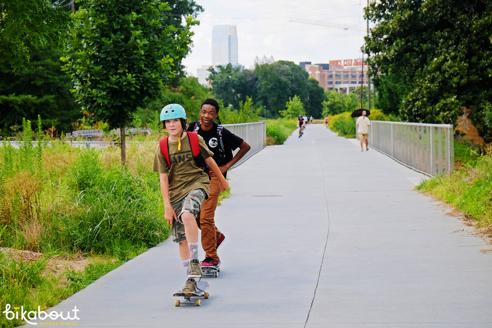 Guys on the way to the 1st class skateboard park right off the Beltline.