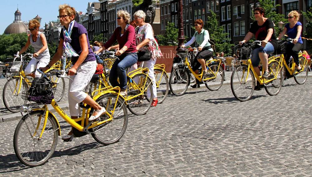 Bike tour in Amsterdam. Photo credit to IAmAmsterdam.com