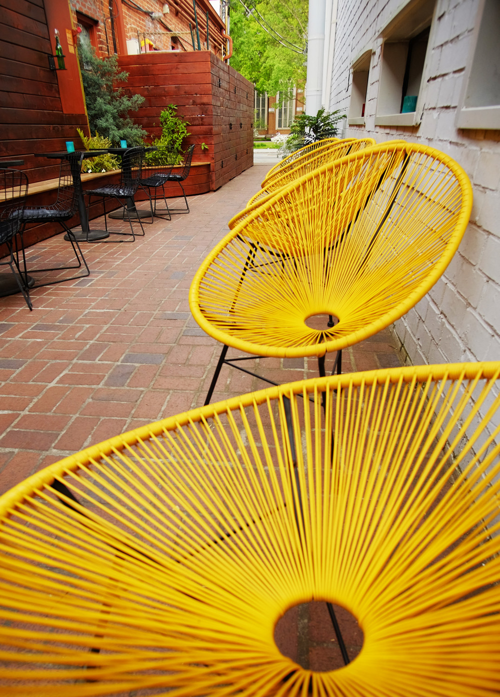 S.O.S Tiki Bar's side patio is located behind Victory Sandwich Bar
