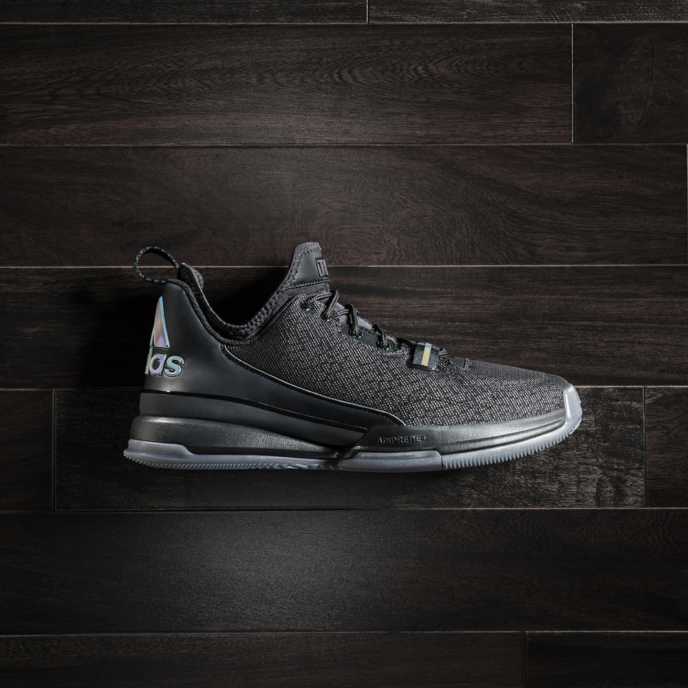 buy online e29df faa2f The Adidas D Lillard 1 has a black mesh upper that intertwined with grey.  The iridescent material hits the Adidas logo on the back heel, along the  tongue, ...