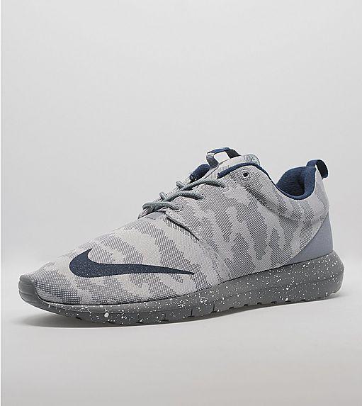 d8f6e43a605 Nike Sportswear Brings Back The Roshe NM and Huarache Light In A Camo Pack  — Sneaker Shouts