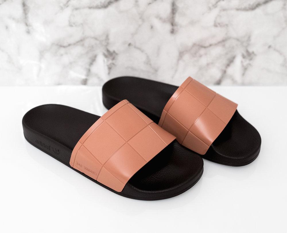 8f7a842ac992 On Sale: Raf Simons x adidas Adilette Slides