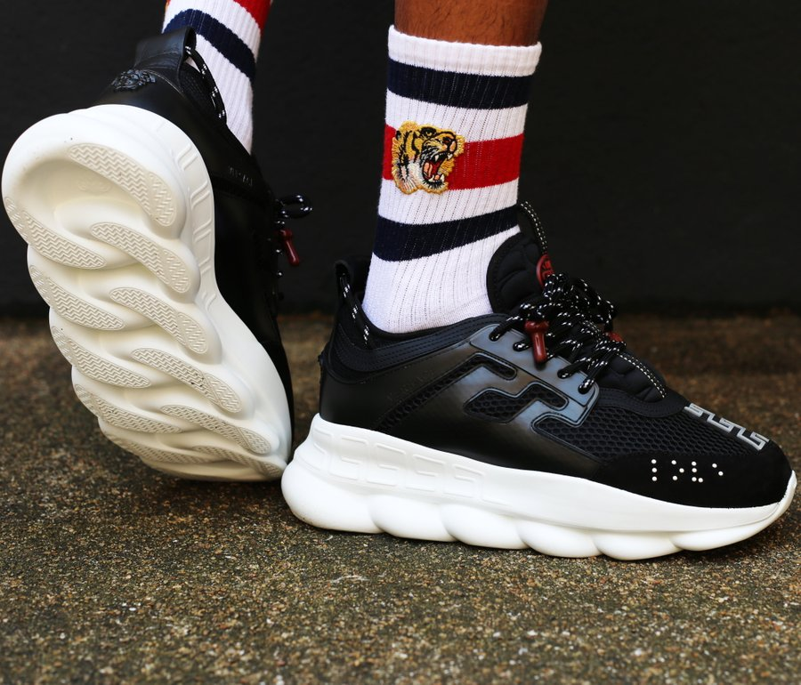 all white versace chain reaction