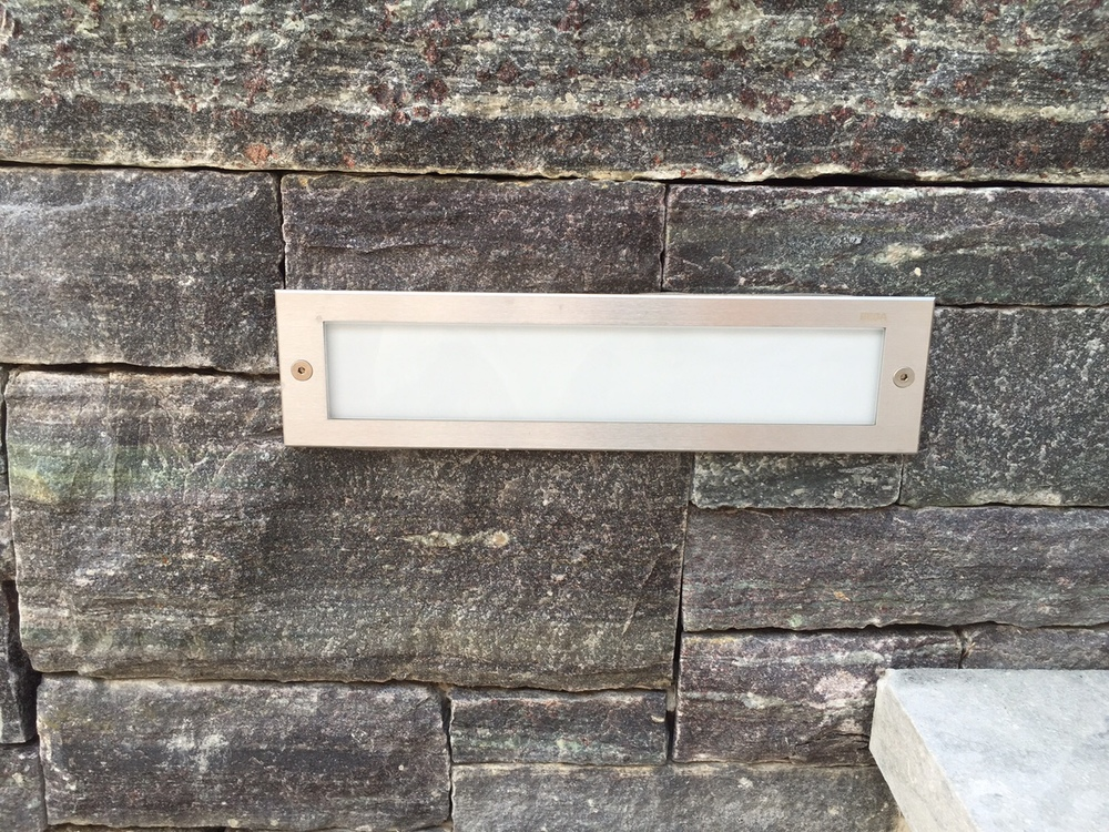 These recessed step lights are by Bega, set directly into the Fieldstone wall.  View Product Website