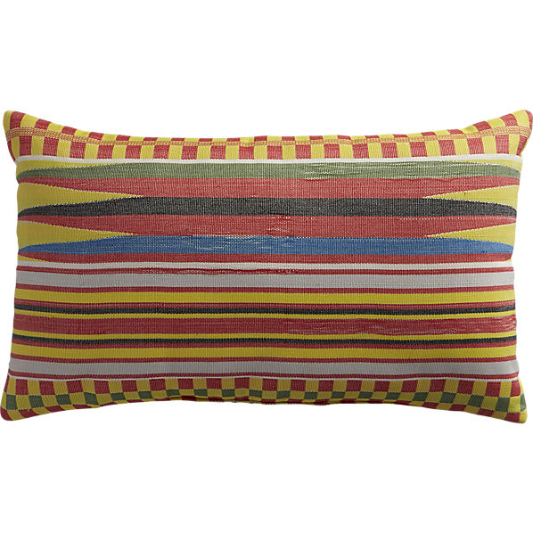 A Jacquard textured throw pillow adds a twist of island chic. View Product Website