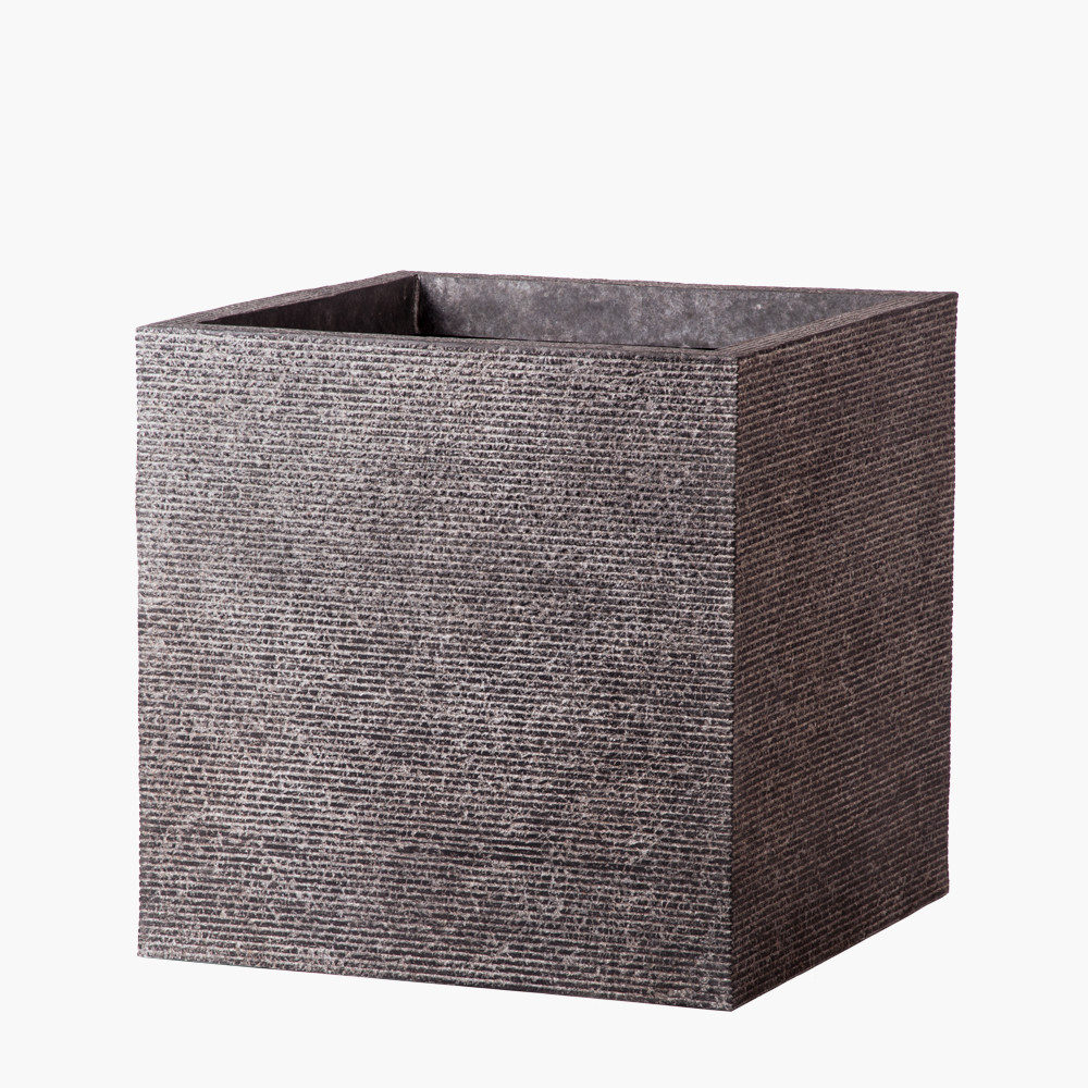 This lighter weight fiberstone planter by Stone Yard Inc. combines an organic and relic-like look with a geometric modern shape. View Product Here