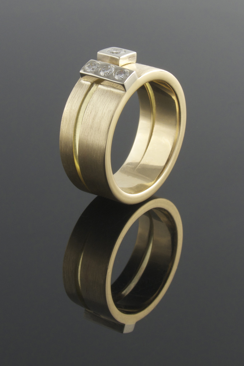 Two tiered recycled yellow gold ring with four punch set diamonds