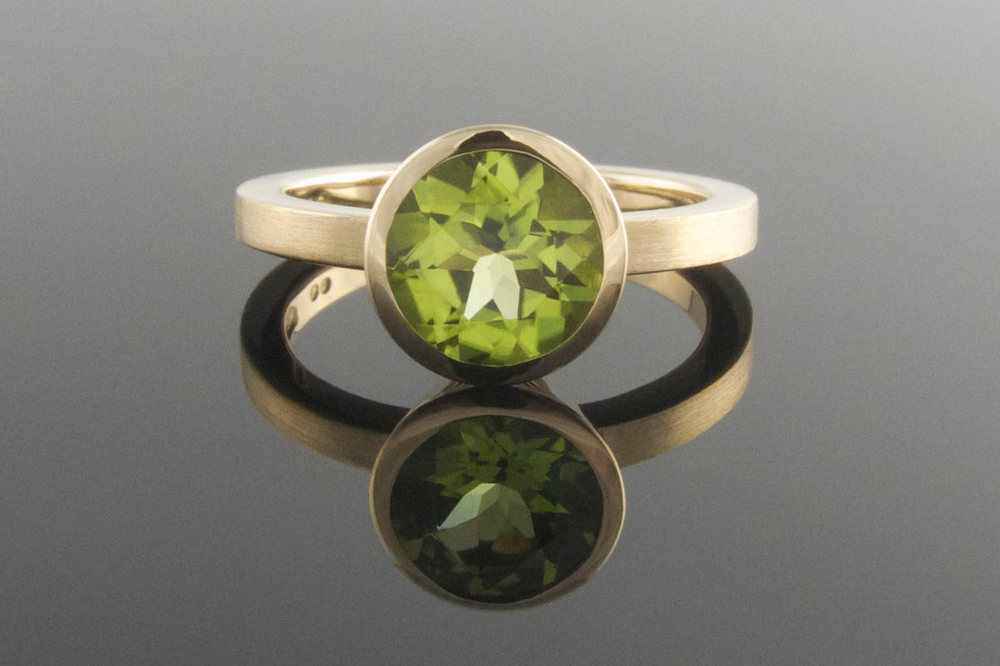 Bezel set peridot engagement ring