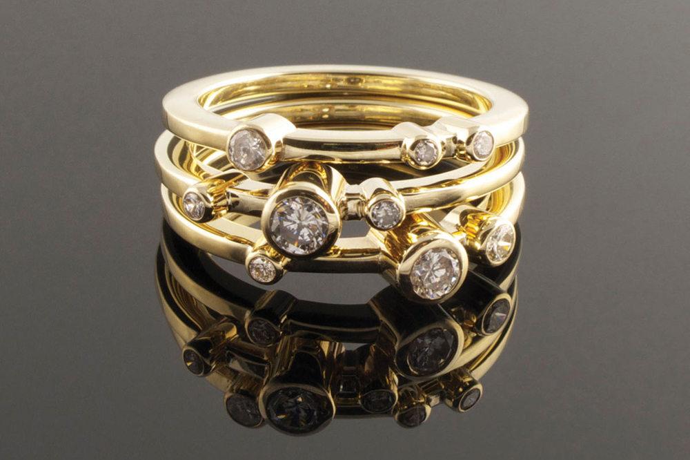 Three yellow gold and diamond rings