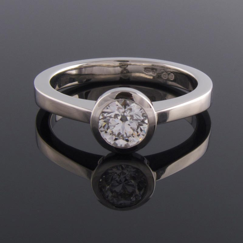 Bezel set platinum solitaire engagement ring