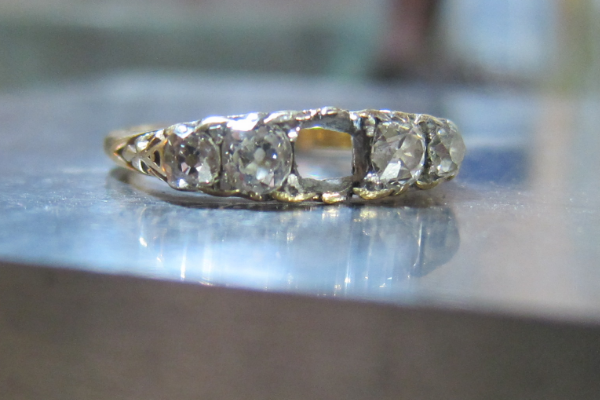 Well loved vintage five stone ring