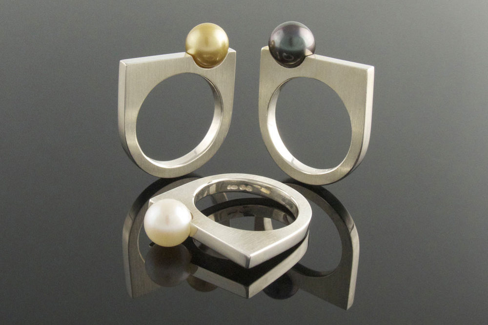 Silver and pearl rings