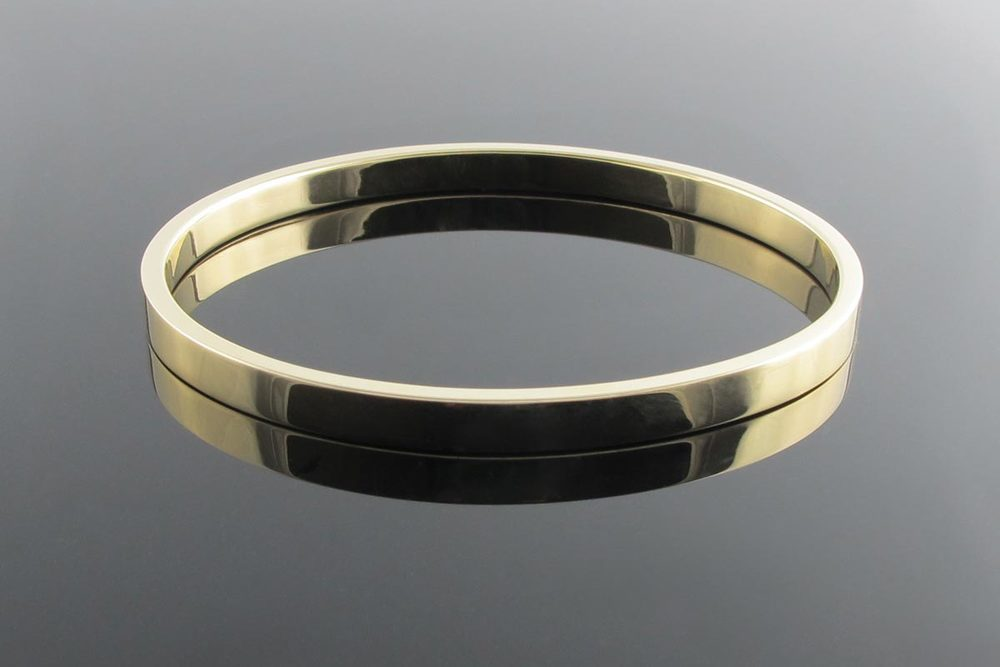 oval yellow bangle hinged solid gold brilliant cut bangles featuring diamonds item