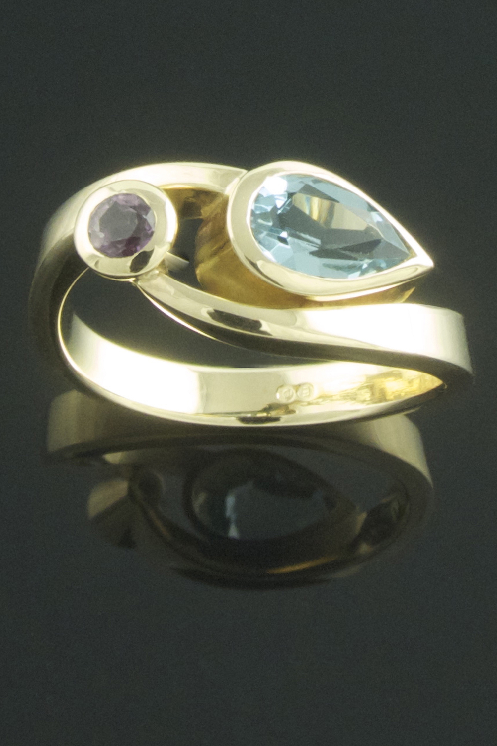 Twisted sapphire and aquamarine ring