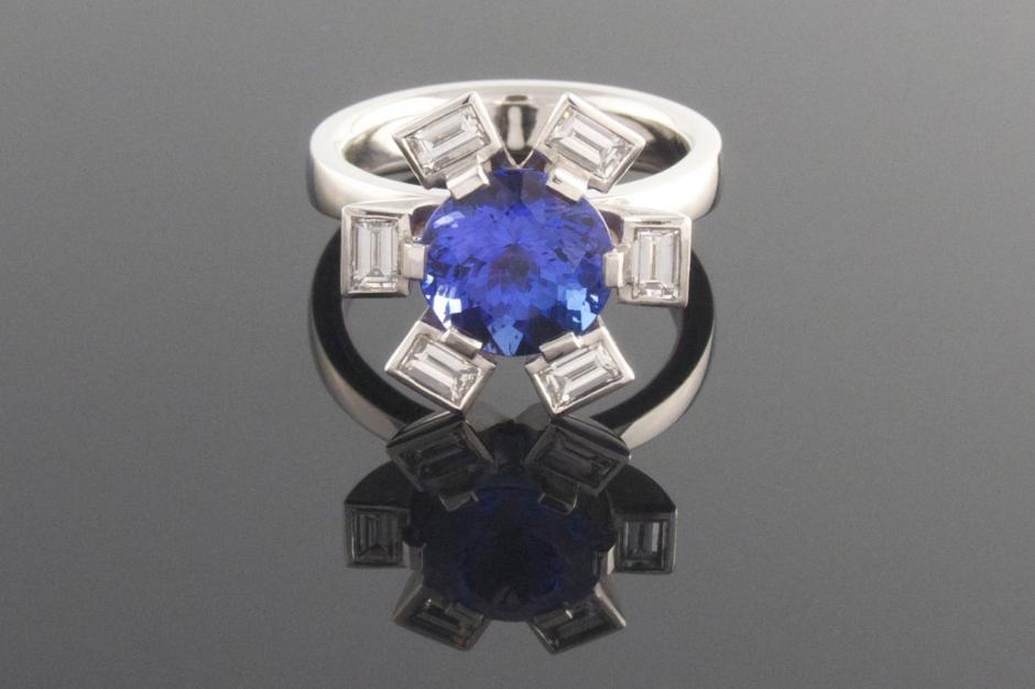 Platinum 6 claw tanzanite and diamond dress ring