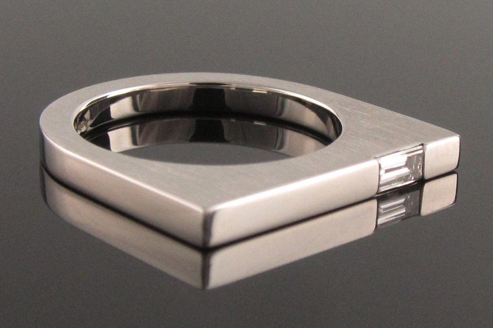 Baguette diamond platinum solitaire engagement ring