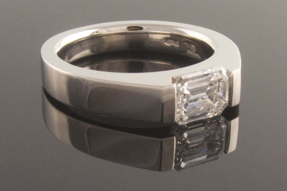 Platinum emerald cut diamond solitaire