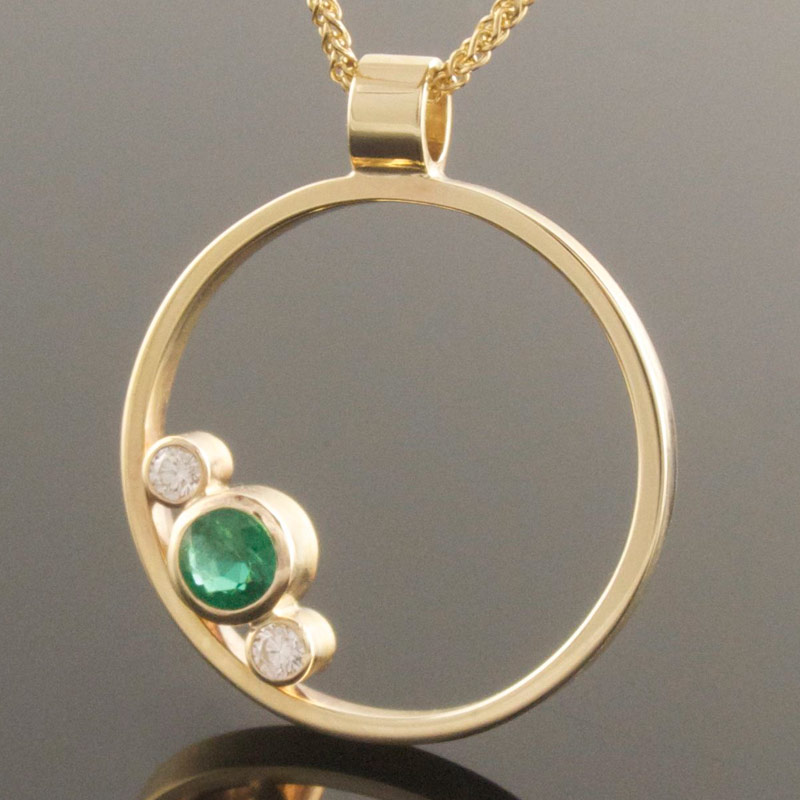 Emerald-and-diamond-circle-pendant.jpg