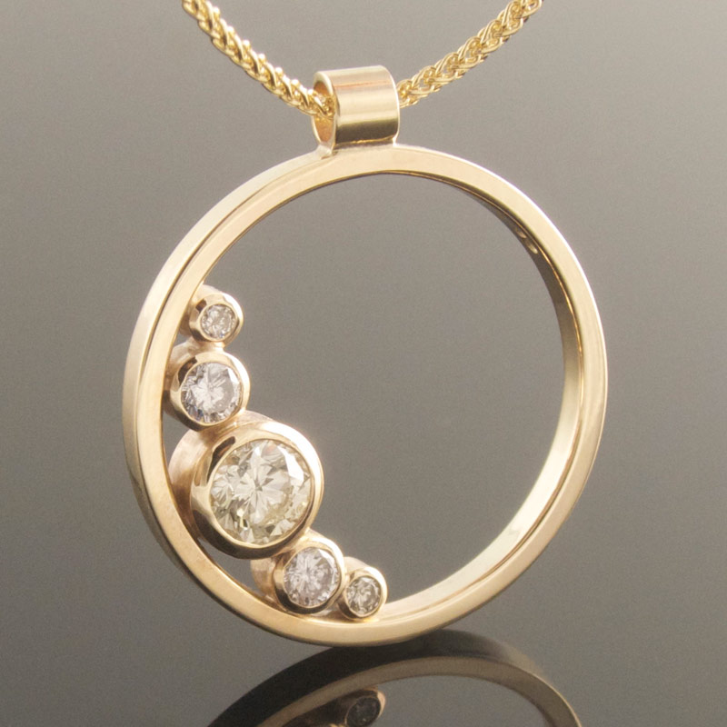 Graduated-5-stone-diamond-circle-pendant.jpg