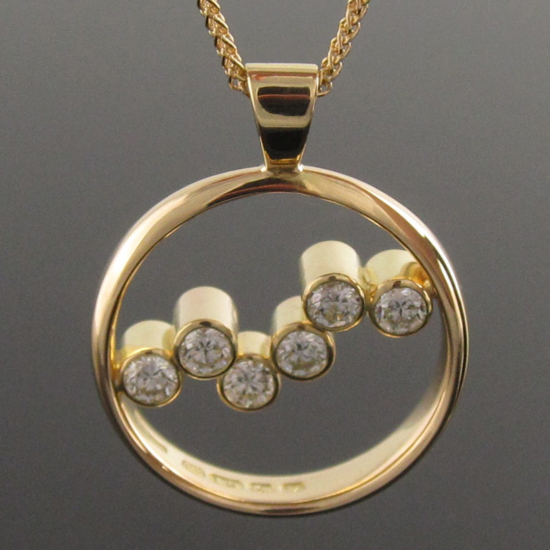 Seven-stone-diamond-circle-pendant.jpg
