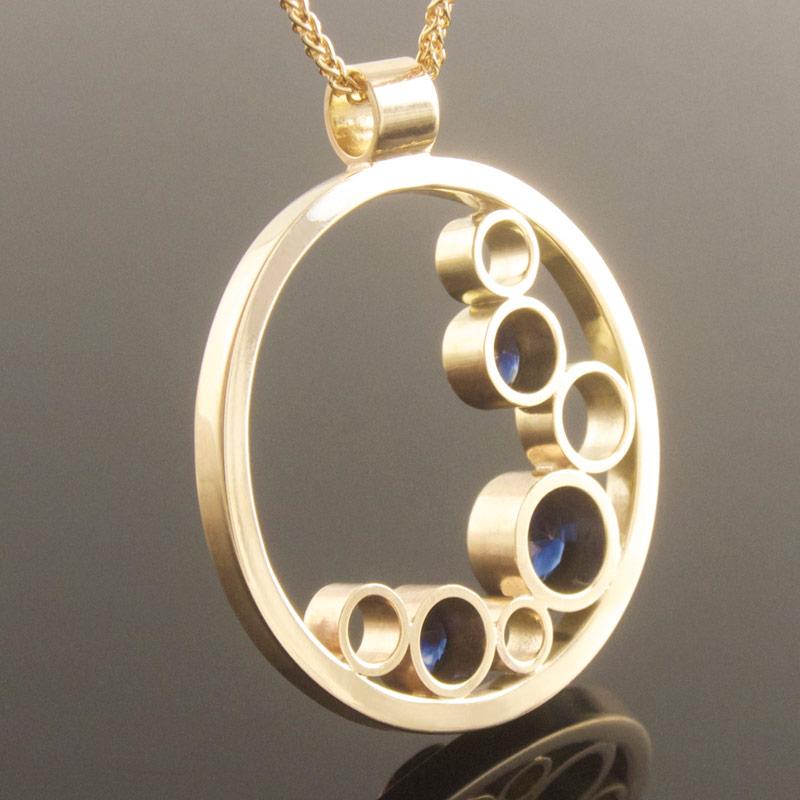 Three-stone-sapphire-circle-pendant-reverse.jpg