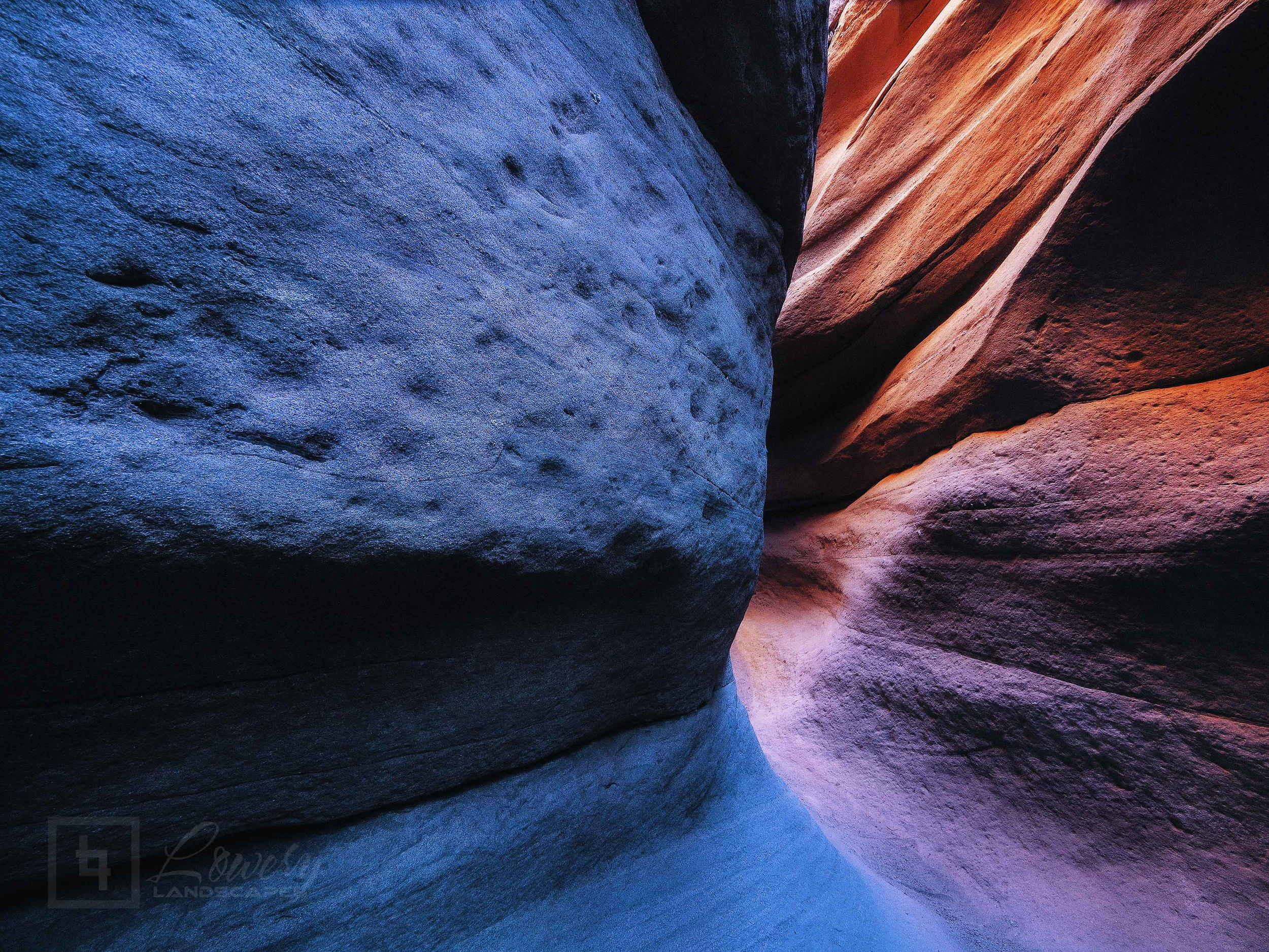 Rosy golden light reflects down into this deep slot canyon in Southern California's Colorado Desert Region.