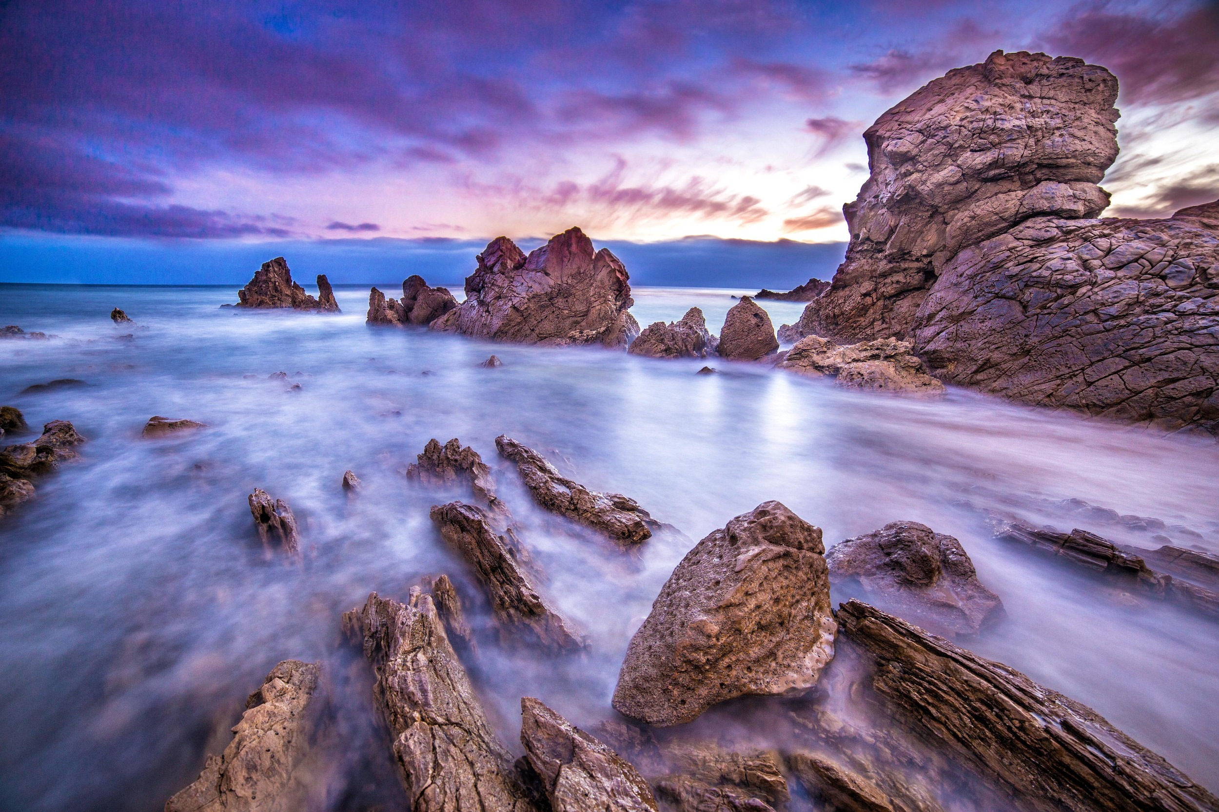 Four wave cycles are captured in this internationally published long exposure blend image from sunset in Corona Del Mar, California.