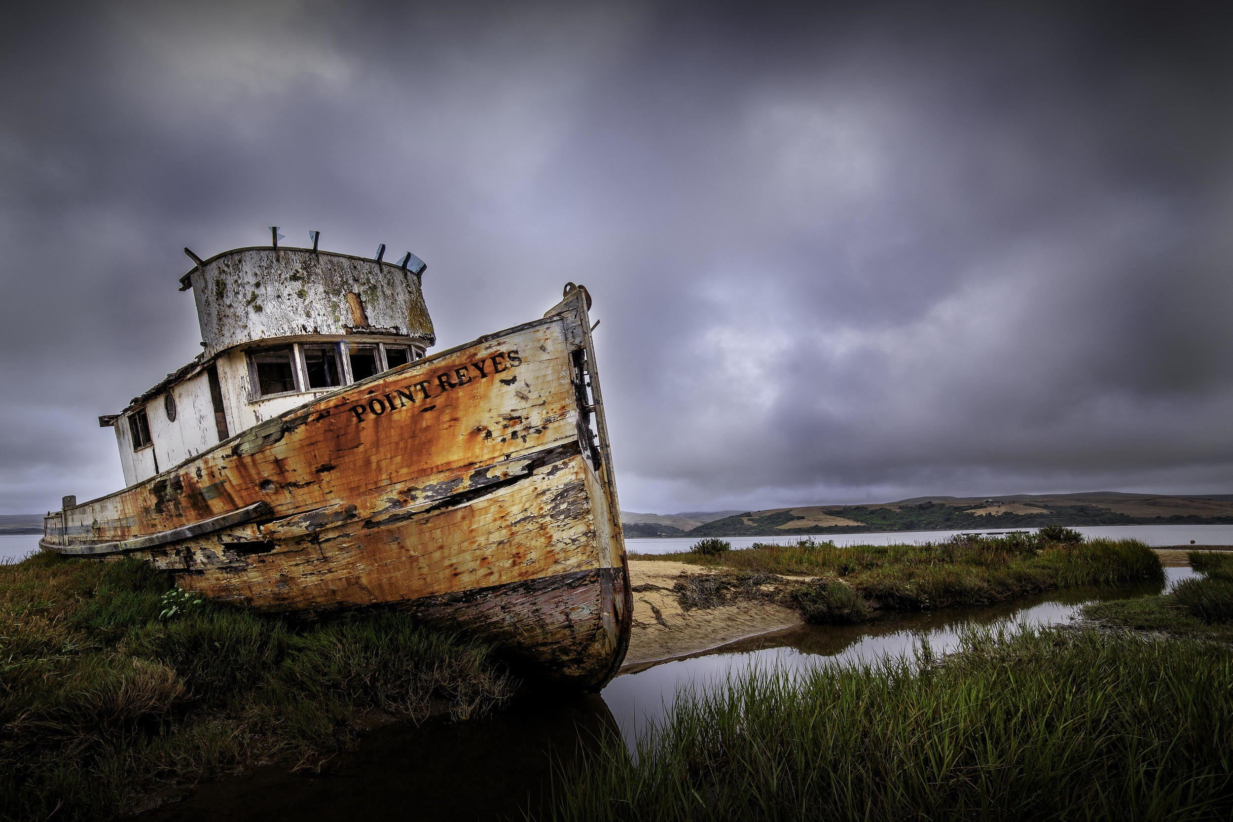 The S.S. Point Reyes was an oyster vessel before it became unseaworthy and was abandoned during a storm off the coast of California, where it drifted ashore and still rests on the foggy shoreline of the Tamales Bay to this day.
