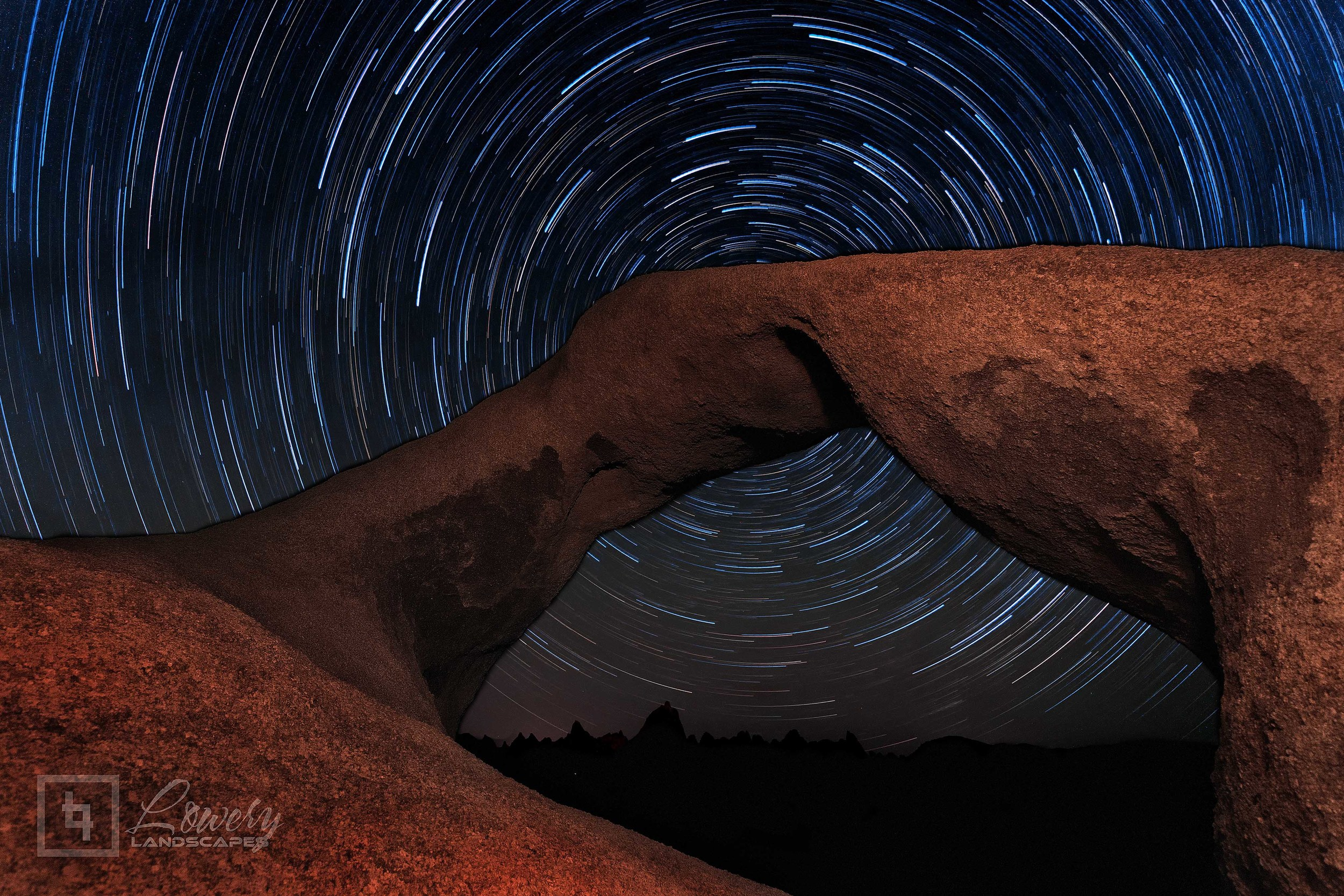The Earth's rotation around the North Star, Polaris, streaks the night sky into a spiral of light and color, with the light painted Mobius Arch in the foreground in this 71 minute blend of 16 sequential long exposures.
