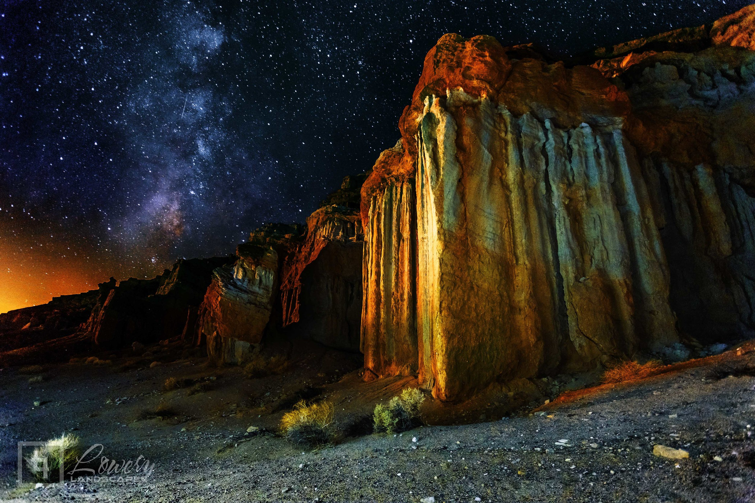 Sandstone Hoodoos are lit by the single LED light on the back of my iPhone beneath the Milky Way in Red Rock Canyon, California in this simple 30 second exposure.