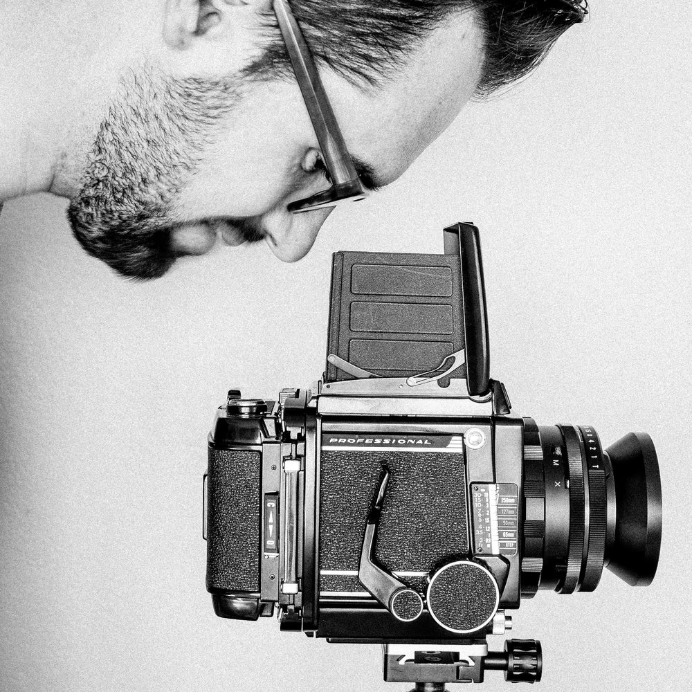 Self portrait with my Mamiya RB67, a medium format film camera which uses 120mm roll film in the 6x7cm frame size. The camera was made around half a century ago.