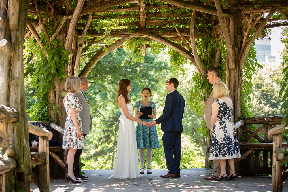 A couple marry at the Dene Shelter in Central Park with Judie Guild officiating.