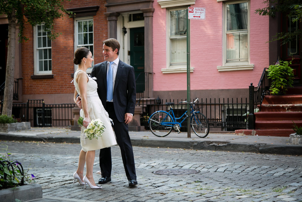 A wedding couple in the West Village following their elopement at NYC City Hall.