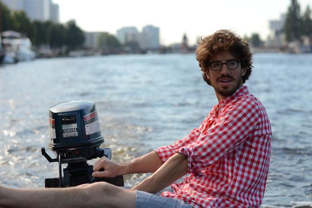 sexy-man-steerinh-boat.jpg