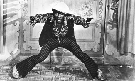 Jimmy Cliff, as gangster Ivanhoe Martin, poses for the camera in The Harder The Come.